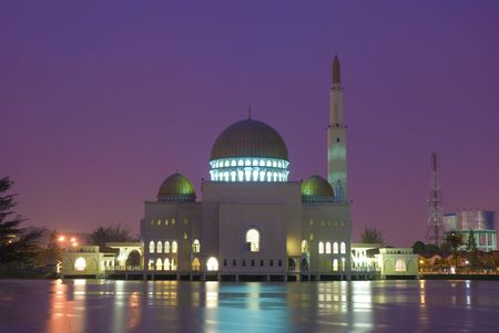 islamic wonderful: mosque with relfection during sunset
