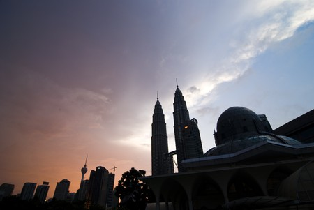 islamic wonderful: silhouette of kl city during sunset