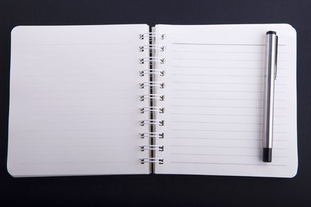 notepad with a pen Stock Photo - 5796423