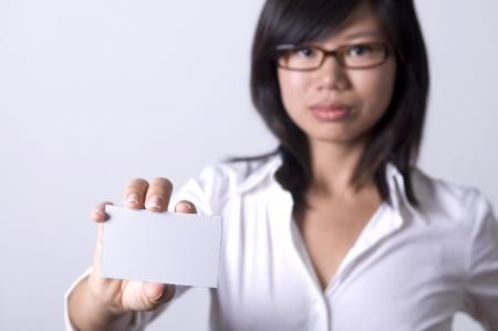 asian business women: asian business women with a blank namecard