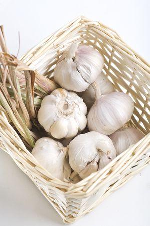 garlic and dried lemon grass inside a basket photo