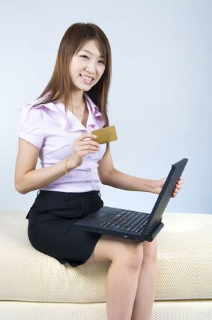 asian business women online shopping with a blank credit card  photo
