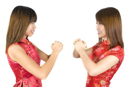 2 chinese new year girl with white isolated background Stock Photo - 6337281