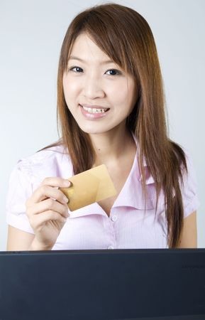 asian businesswomen on a laptop with cred card Stock Photo - 6337290
