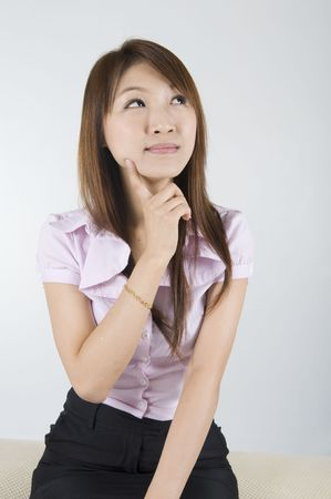 asian business women: asian business women having a thought Stock Photo