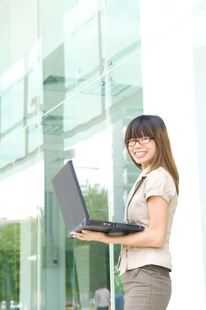 asian business women: asian business women smiling with a laptop  Stock Photo