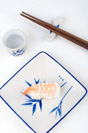makki: sushi with chopstick and plate Stock Photo