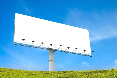 blank billboard with blue sky and green grass photo