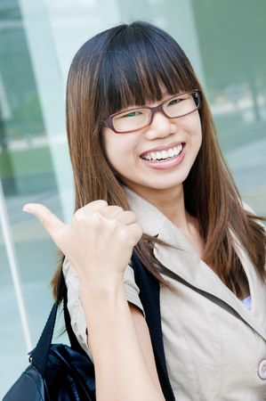 asian business women: asian business women with a thumbs up