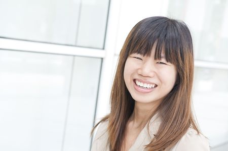asian business women: asian business women smiling with office background