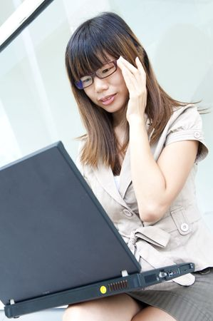 asian business women on a laptop Stock Photo - 6619181