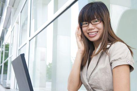 asian business women on a laptop photo