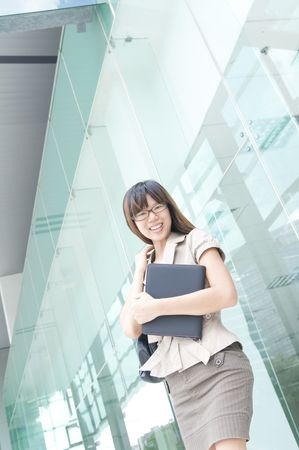 asian business women: young asian business women smiling with a notepad  Stock Photo