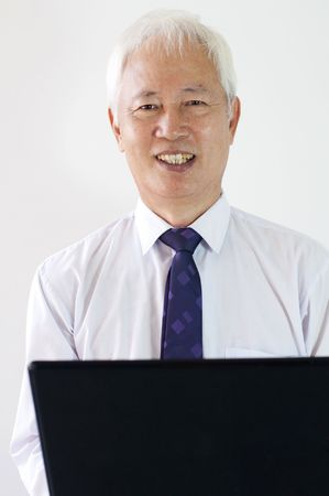 old asian chinese business man with a laptop photo