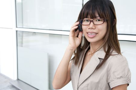 asian business women: a happy asian business women on a phone conversation  Stock Photo
