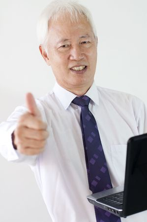 asian etnic business man with a laptop and thumbs up  photo
