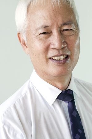 close up shot of senior asian business man smiling photo