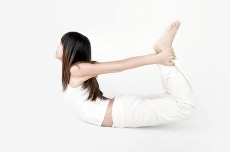 high key of asian girl performing yoga with light background Stock Photo - 6973808