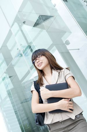 asian business women: asian business women with a folder and office background Stock Photo