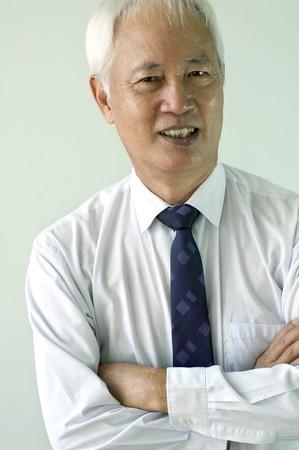 senior asian busines man smiling in formal clothing photo