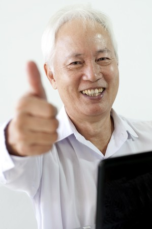 senior asian business man with laptop and thumbs up photo