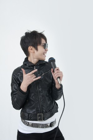 asian female rock star holding a microphone and singing photo