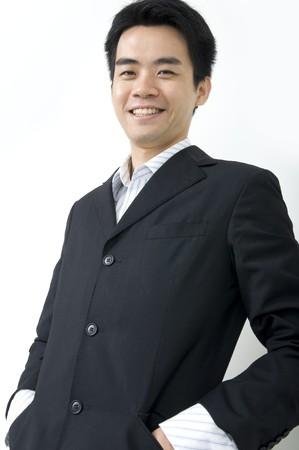happy asian business man wearing a coat photo