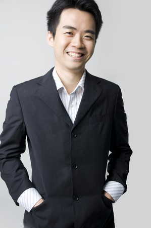 portrait of a happy smiling young asian businessman photo