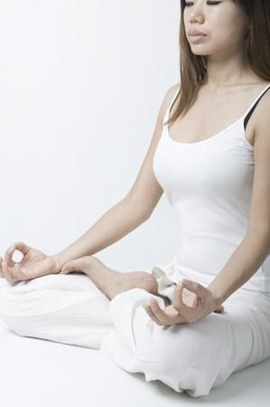 close up shot of asian girl performing yoga  Stock Photo - 7096586