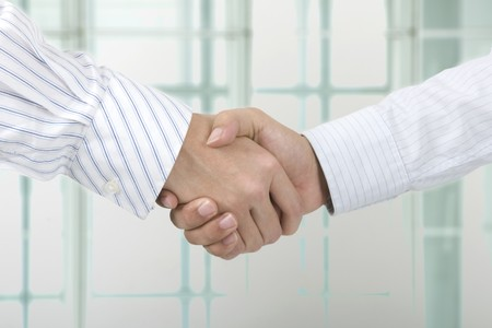 close up face shot of business hand shake photo