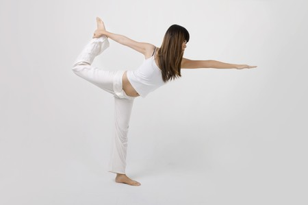 asian girl performing yoga in a studio  Stock Photo - 7215787