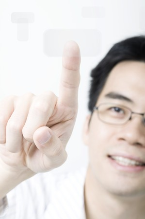 Asian business man pressing a touchscreen button Stock Photo - 7215791