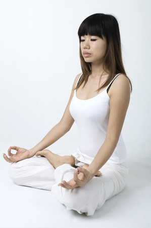 portrait of an asian girl performing yoga in a studio Stock Photo - 7215803