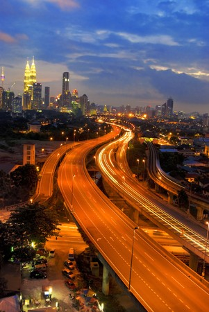 famous landmark of kuala lumpur with fast moving vehicle on highway Stock Photo - 7229762