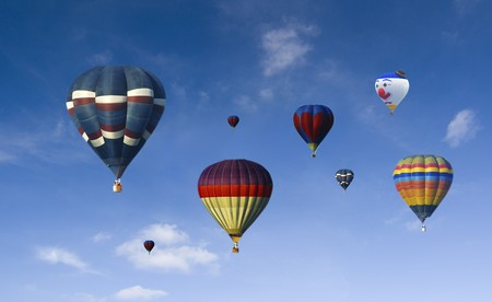 room air: a lot of hot air baloons with blue sky background  Stock Photo