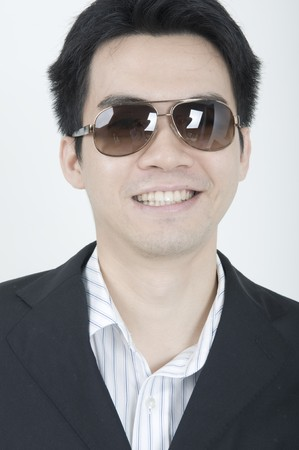 portrait of a young asian business man smiling photo