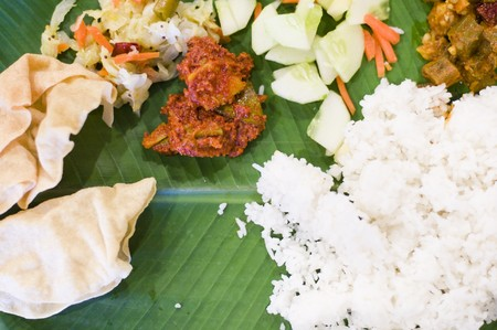 south indian delicacy fresh banana leaf meal photo
