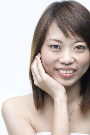 close up shot of a smiling asian girl photo