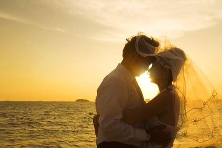 romantic asian couple kissing on a beach during wedding day Stock Photo - 7508674