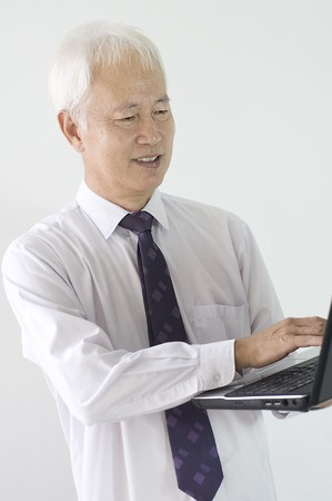 asian senior business man with a laptop Stock Photo - 7638970