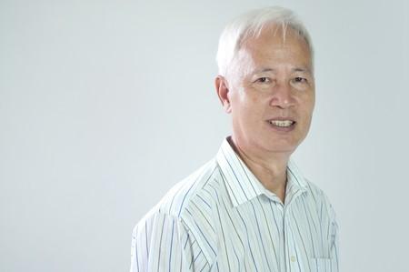 close up portrait if senior asian business man   photo