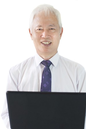 senior asian business man with a laptop Stock Photo - 7888666