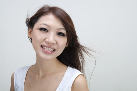 asian girl smiling with plain background photo