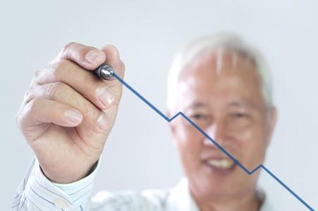 senior asian business man drawing upward trend graph  photo
