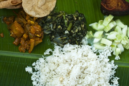 famous south indian banana leaf meal photo