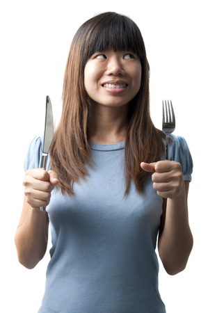 avid: asian women with fork and spoon isolated on white
