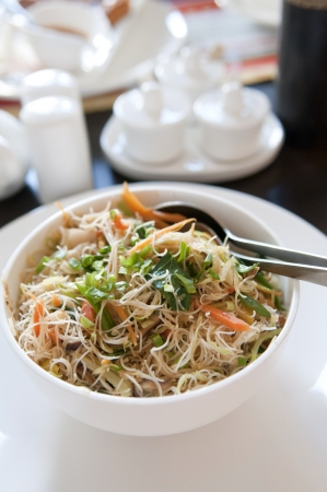 rice noodles: chinese fried beehoon with cockery  Stock Photo