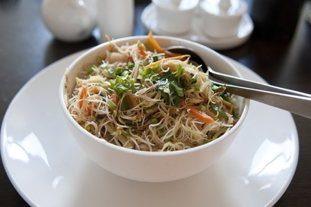 asian fried rice noodle on a bowl photo