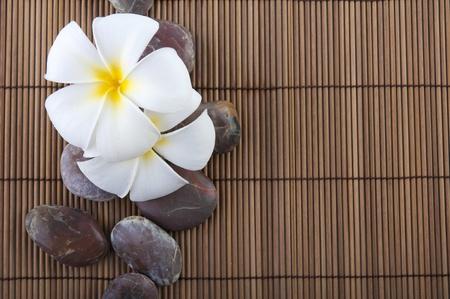tropical spa with frangipani flowers photo