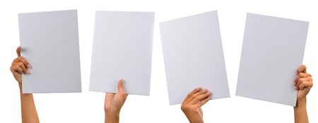 various blank cardboard with hands isolated on white photo
